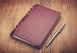 shutterstock notebook and pen on wood background memoirs diary