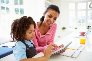 shutterstock Mother And Child Using Digital Tablet For Homework